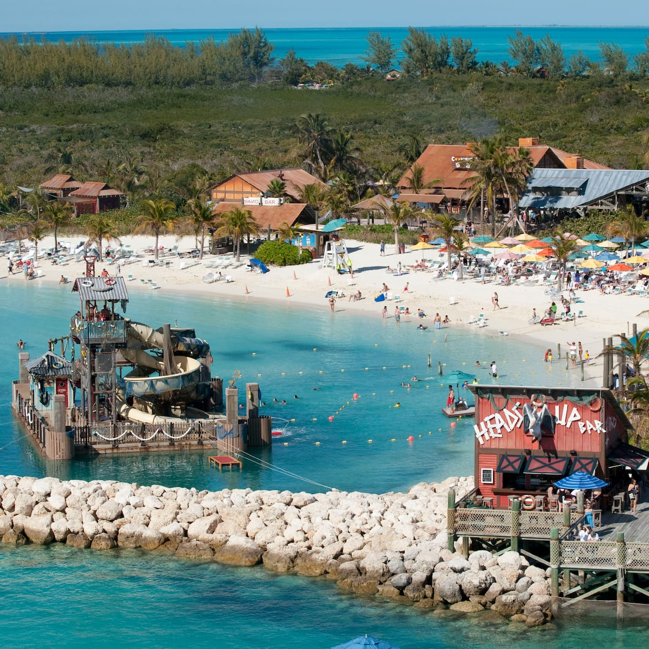 The cove, beach area, Heads Up Bar and several island-style buildings on Castaway Cay
