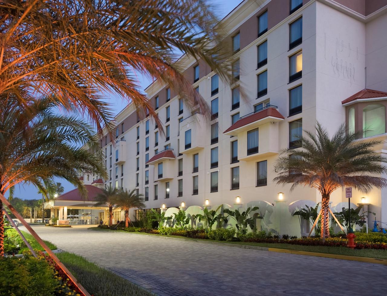 The 7 story exterior of the Delta Orlando Lake Buena Vista hotel