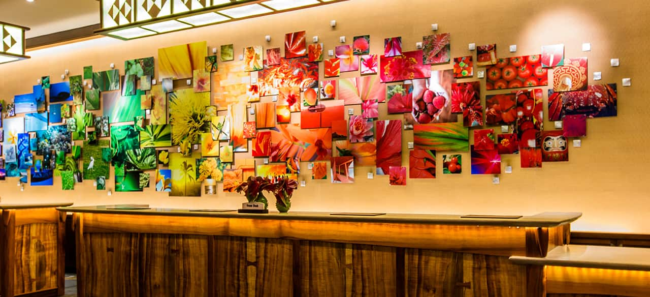 The Front Desk At Aulani Features A Large Display Of Artwork Pictures