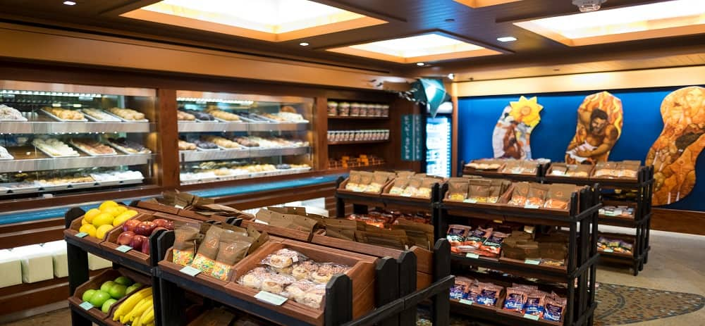 Inside the Ulu Cafe store, with rows of pastries, fruit, juice and chips