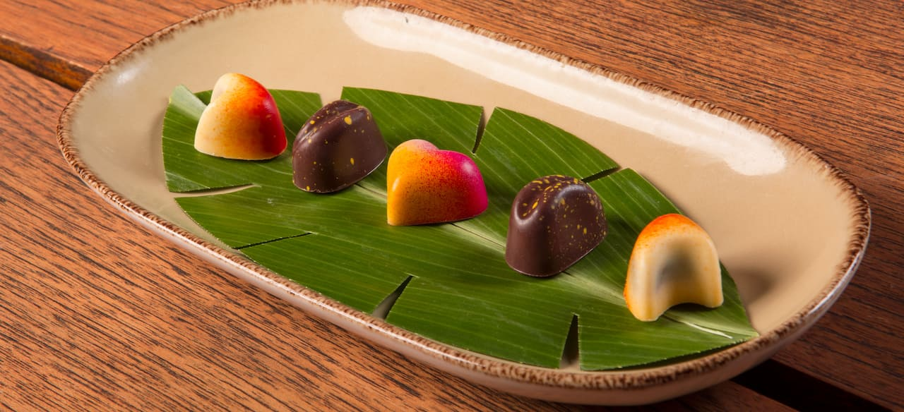 An elegant selection of candies is presented on a serving dish.