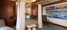 The private bedroom of the deluxe 1-bedroom suite at Aulani