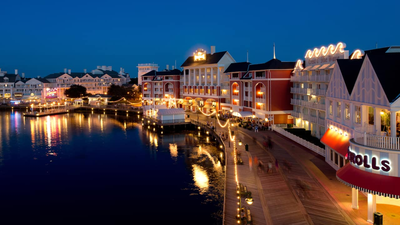 The Disney Boardwalk Inn shines brightly in the night sky