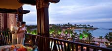 A couple peers over the balcony at Ko Olina Beach