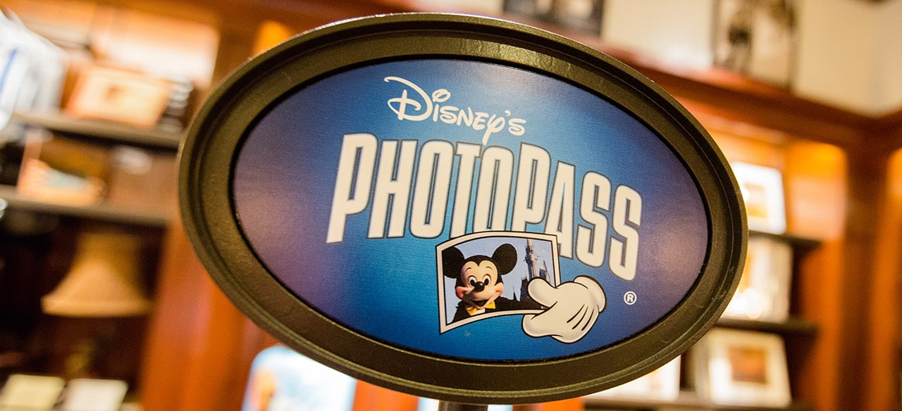 A sign for Disney PhotoPass service