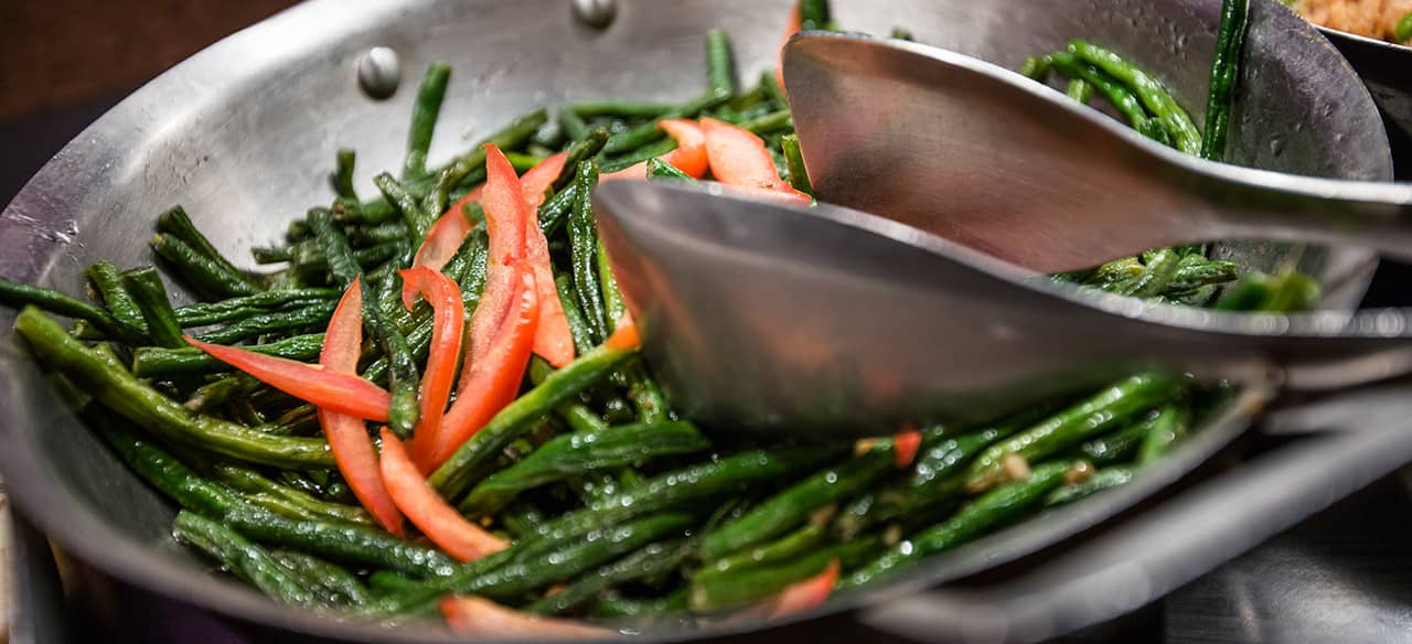 A wok filled with stir fried vegetables