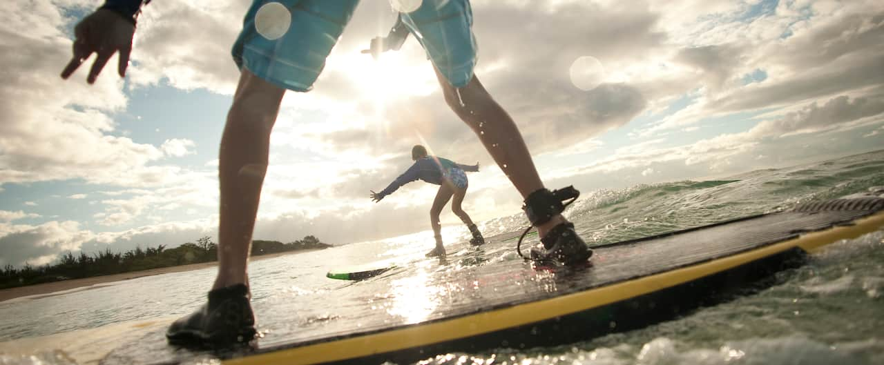 Guests learn how to surf in the ocean