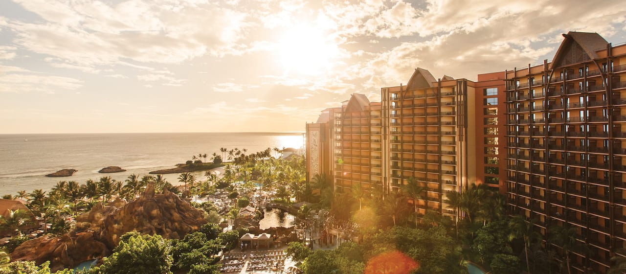 The Aulani Resort with an ocean backdrop at sunset