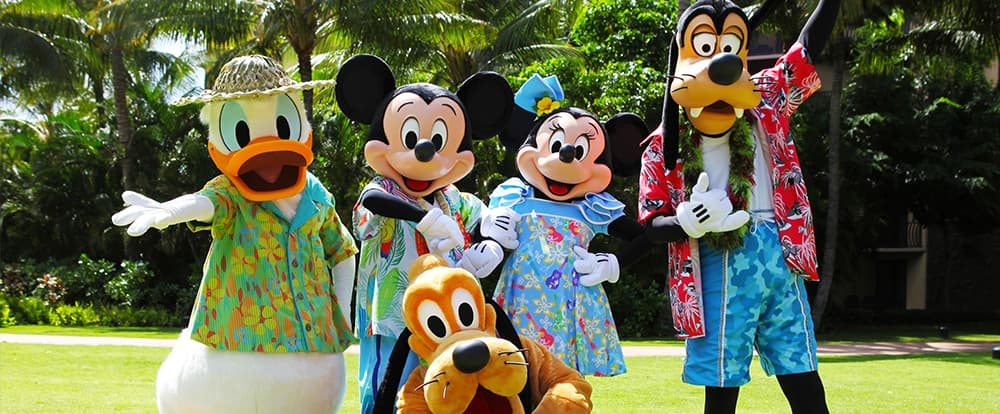 Donald Duck, Mickey Mouse, Minnie Mouse, Goofy and Pluto, dressed in Hawaiian clothing, pose on the Aulani Resort lawn
