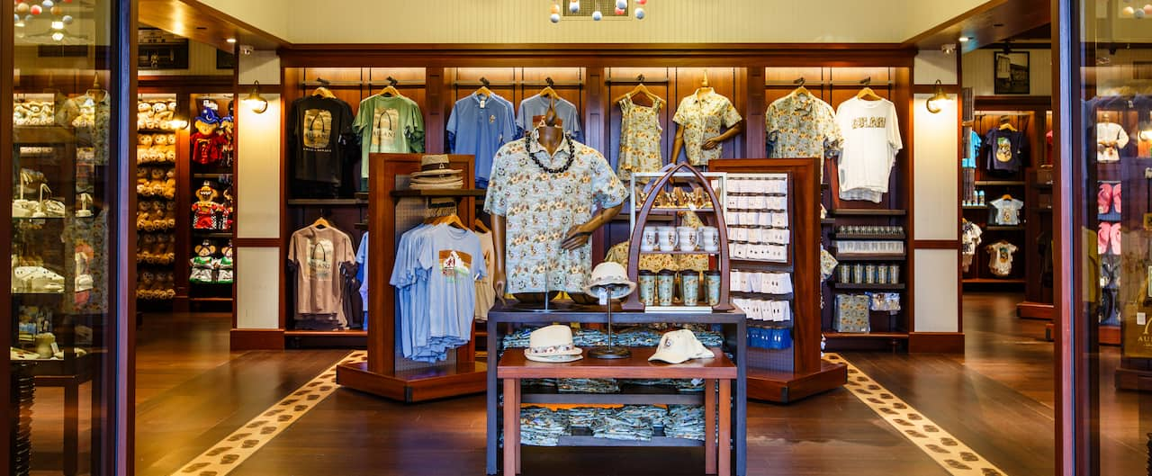 Disney themed resort wear, mugs and jewelry inside Kalepa's Store, the Aulani lobby gift shop