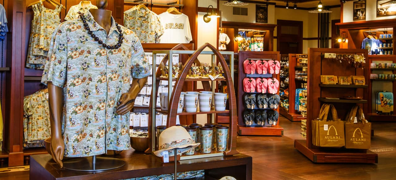 Merchandise displays at Kalepa's Store, including Hawaiian shirts, mugs, flip-flops and tote bags