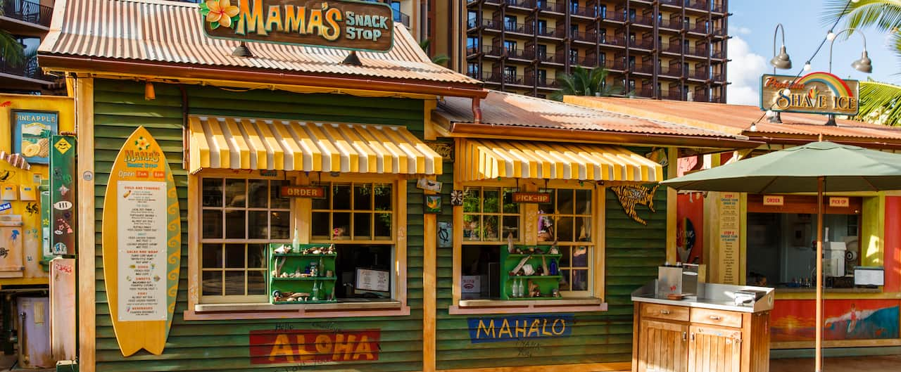 The exterior of Mama's Snack Stop, a quick service venue with weathered paint and awnings