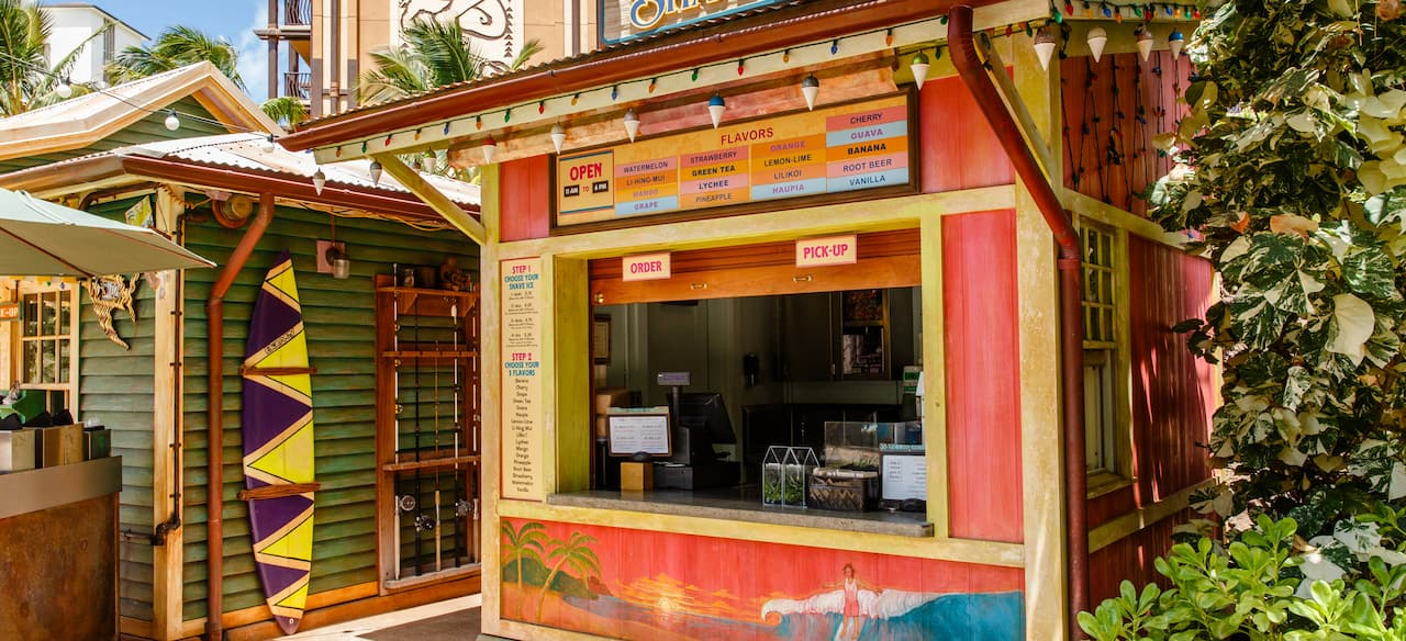 The exterior of Papalua Shave Ice, showing the menu board, ordering instructions and walk-up window