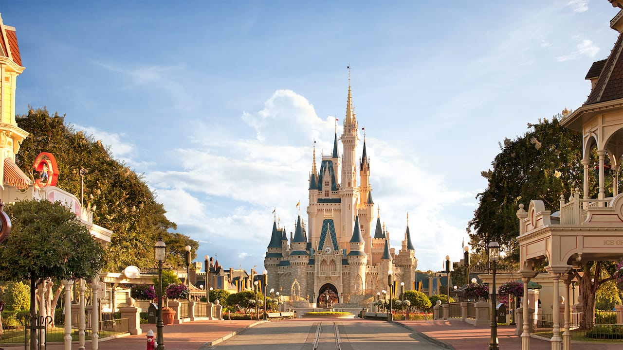 Main Street, U S A, framed by Victorian style architecture, leads toward Cinderella Castle