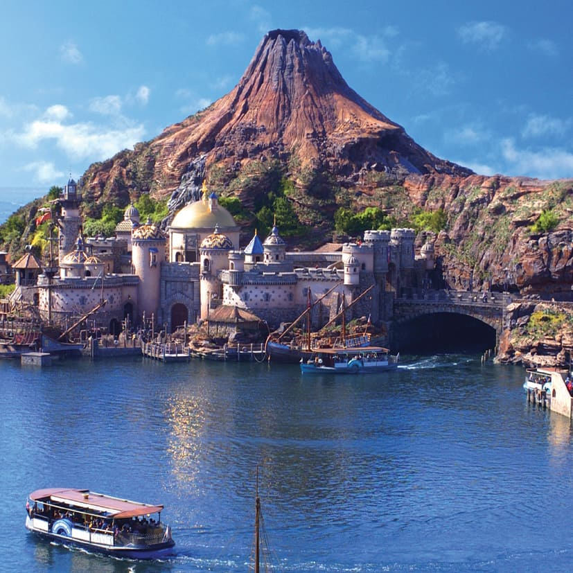 The giant volcano, Mt. Prometheus, looms over a domed building on Arabian Coast Island at Tokyo DisneySea