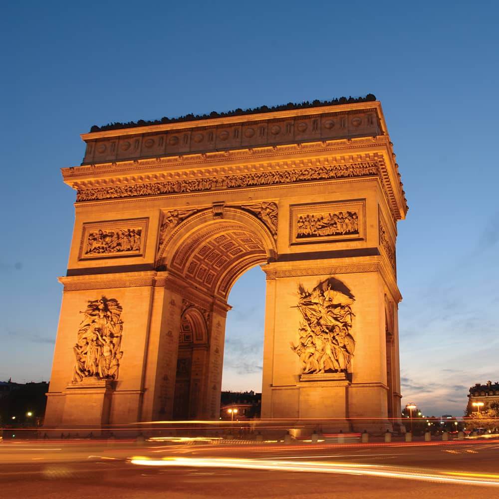 The Arc de Triomphe in Paris, France at night