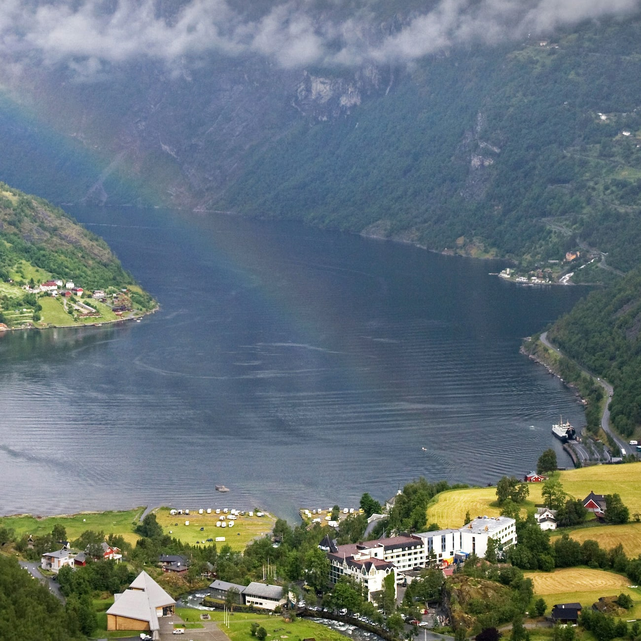 A fjord surrounded by shrub covered mountains