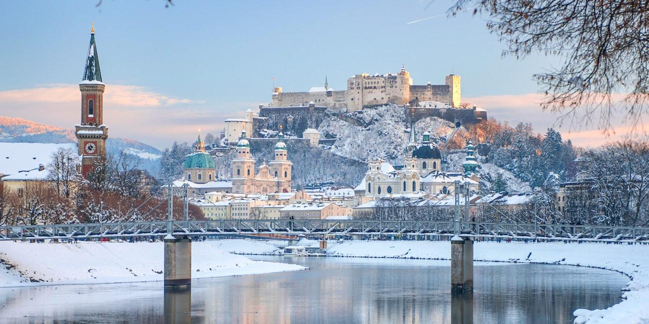The Danube River flows by snowy Salzburg, Austria
