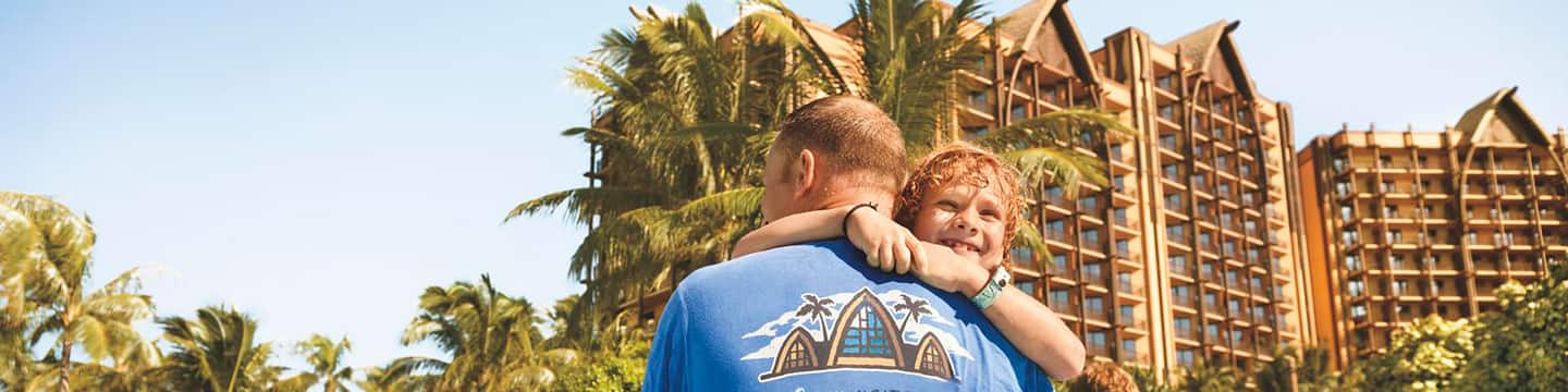 A man carrying his son in a swimming pool at Aulani Resort, and a logo that reads 'The Gift of Disney Vacation Club'