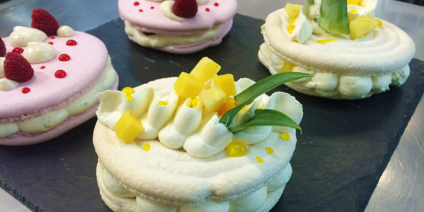 A tray of 4 decorated macarons