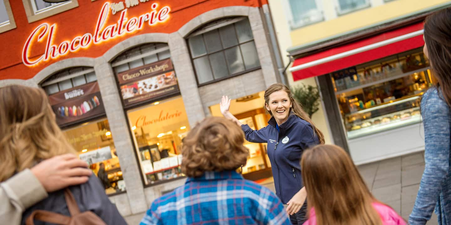 A female Adventure Guide shows Guests a 'Chocolaterie,' where chocolate is made