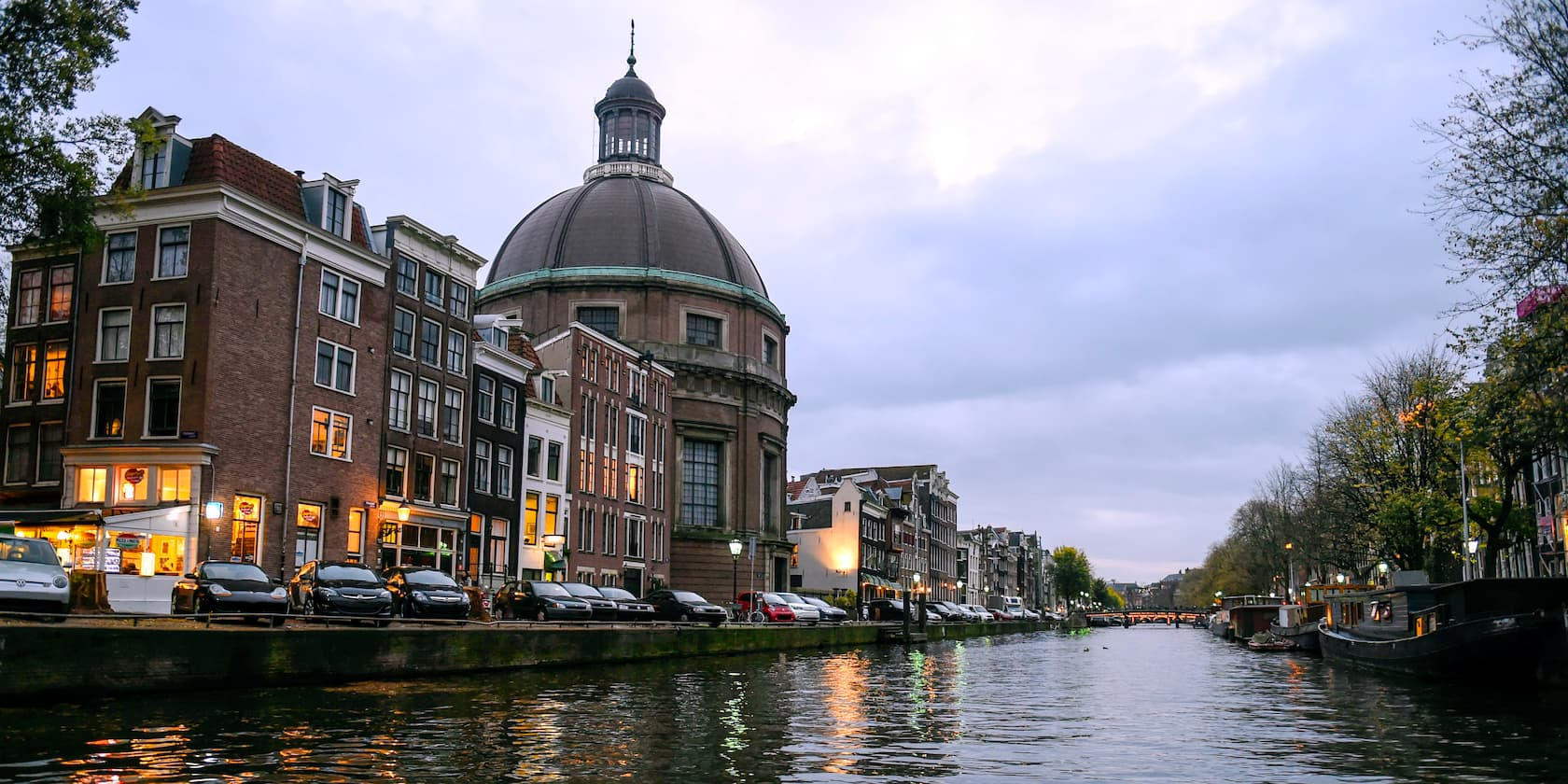 A picturesque view of Amsterdam, with a domed building, taken from the Rhine River