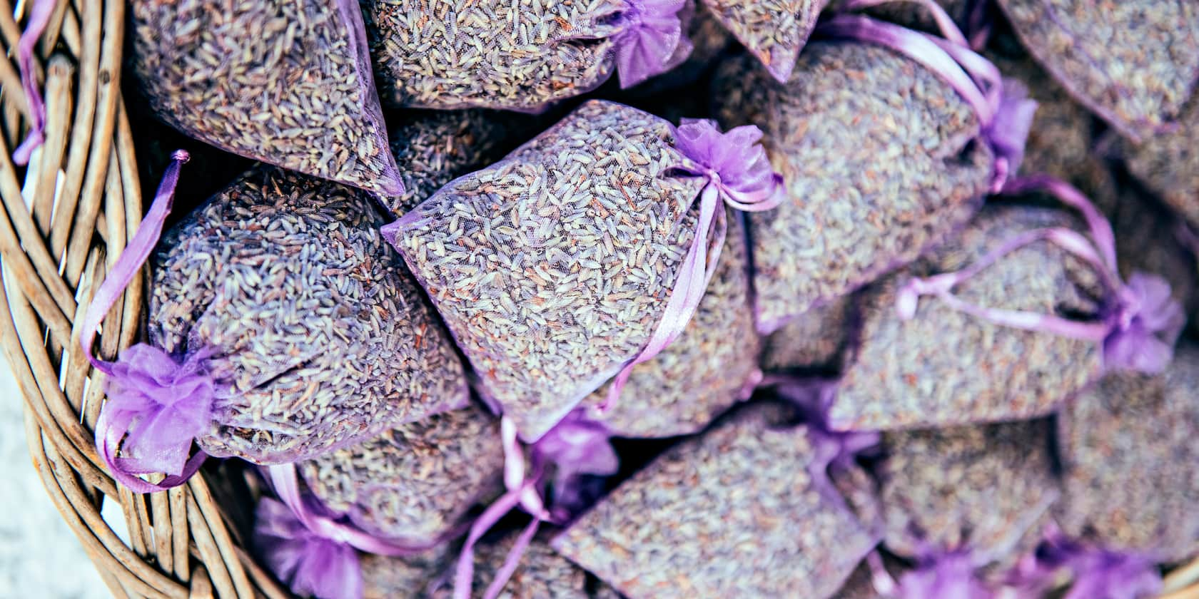 Several small sacks of lavender tied with a ribbon