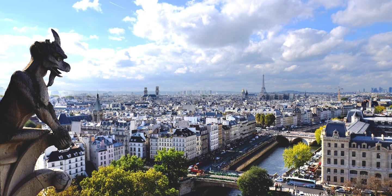 The view of Paris, France from Notre-Dame de Paris along with a gothic stone gargoyle