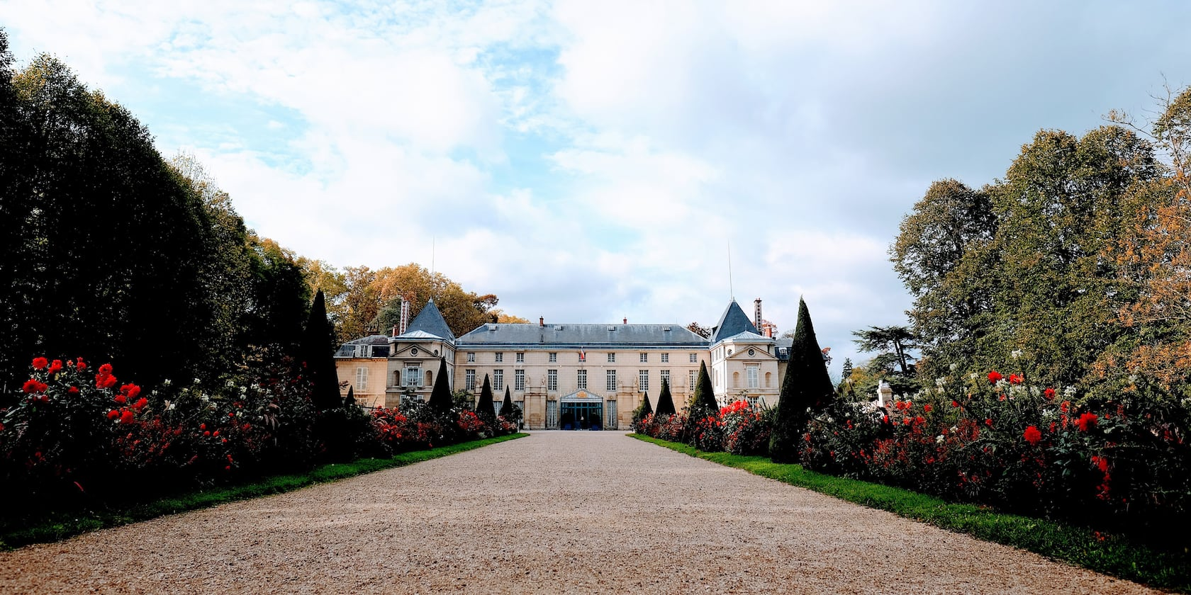 A long, tree-lined driveway leads to Chateau Malmaison in Conflans, France
