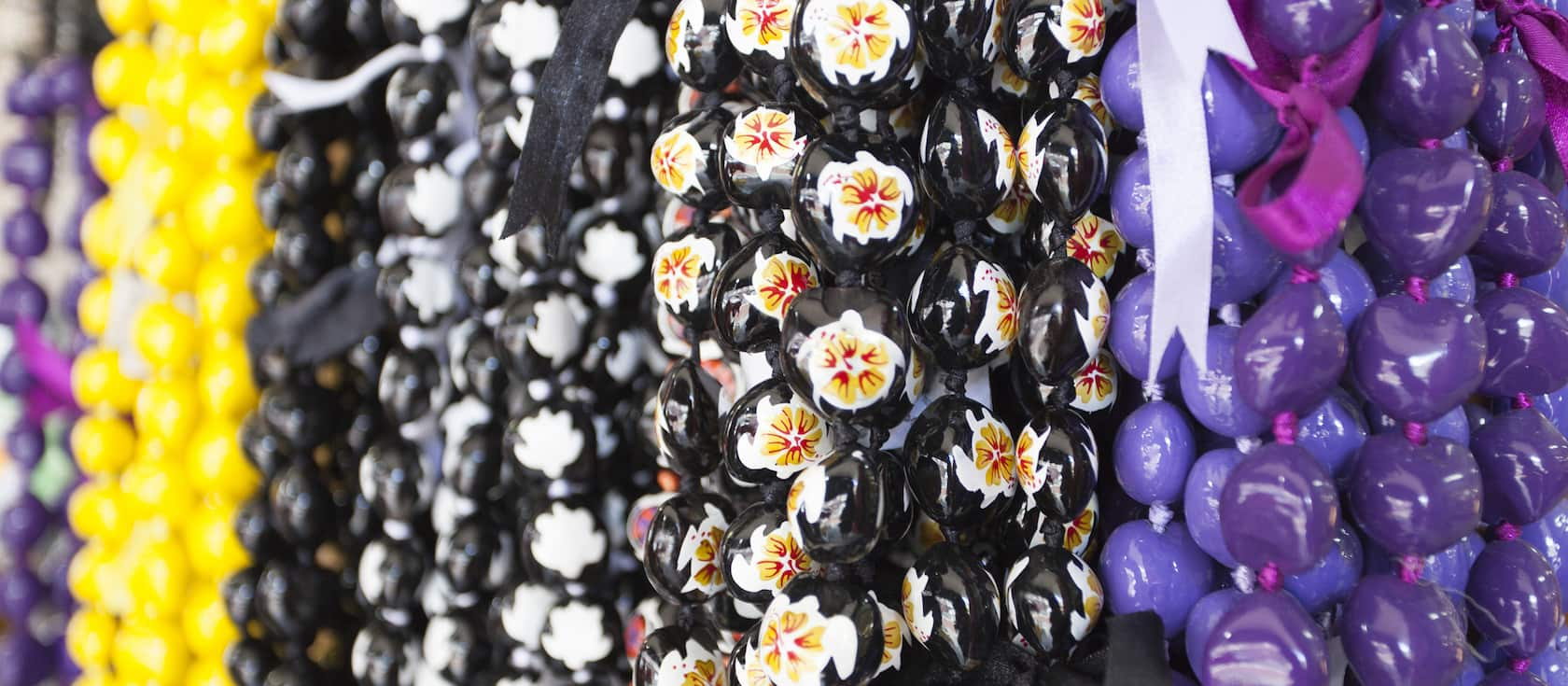 A display of beaded lei necklaces