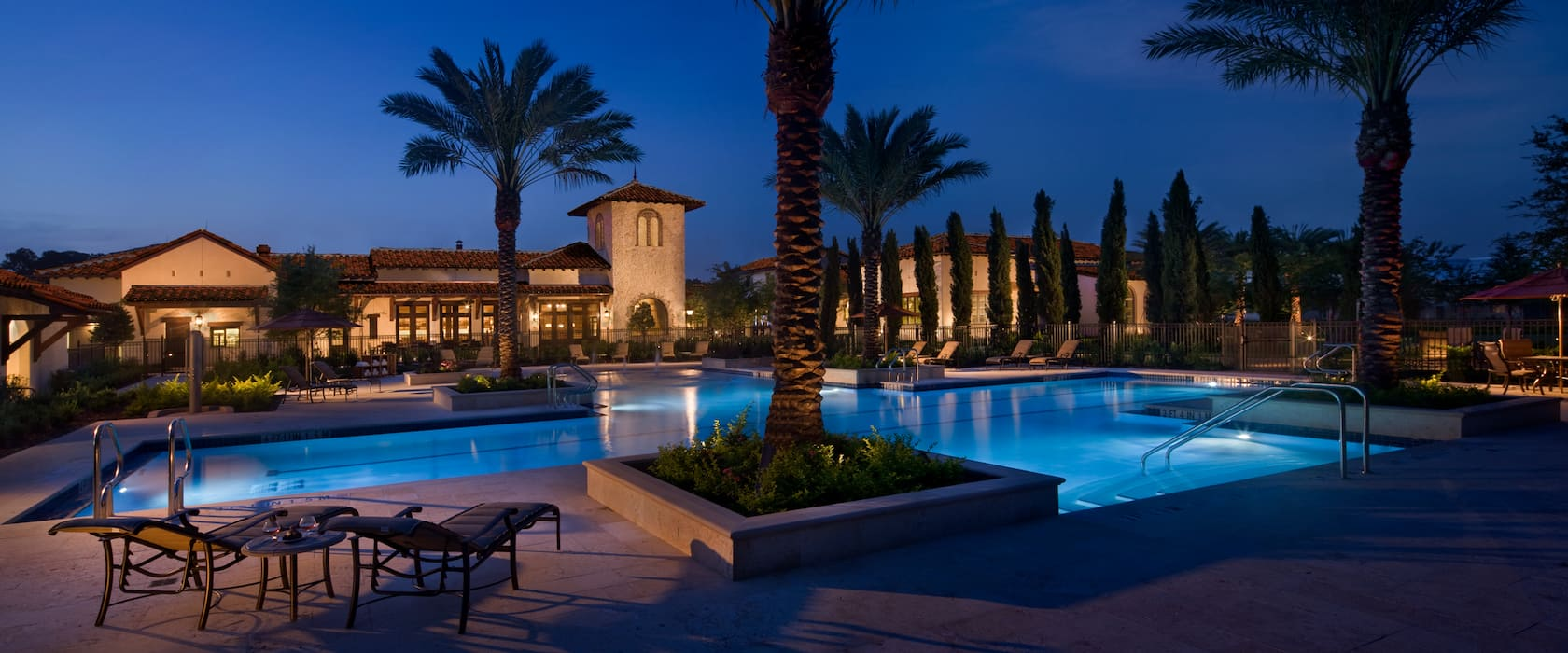 The Golden Oak Clubhouse and pool area lit up at night