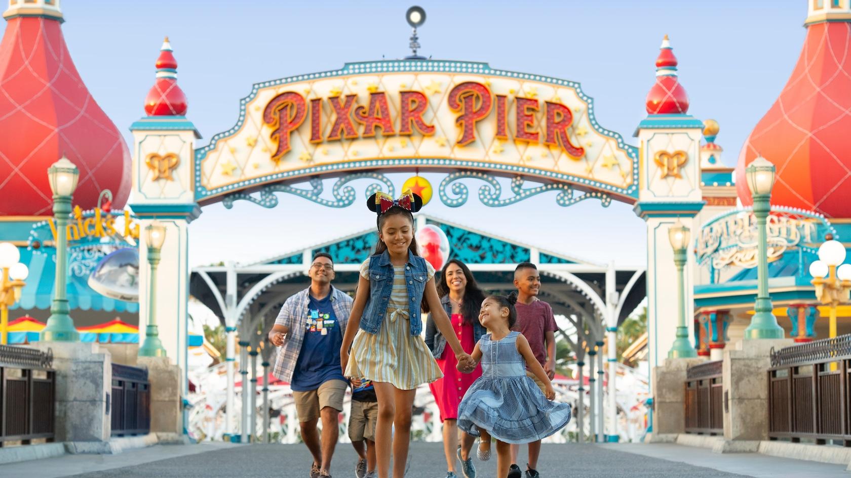 One family walking on Pixar Pier at Disneyland