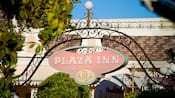A sign that reads Plaza Inn