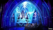 Concept art depicting a group of people watching Elsa sing and create ice fractals