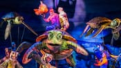 A Finding Nemo show with performers dressed as turtles Marlin and Dory