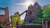 A train speeds through the Himalayan mountains on Expedition Everest Legend of the Forbidden Mountain