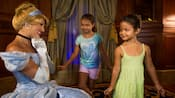 Two little girls practice being princesses for Cinderella