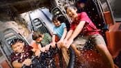 A group of kids ride Grizzly River Run