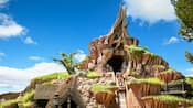 People ride Splash Mountain