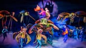 On stage, Characters perform in a production of Finding Nemo the Musical