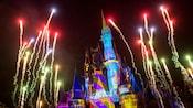 Fireworks soaring over Cinderella Castle