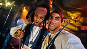 A father and son dressed as pirates