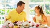 A father and daughter sharing tea and breakfast