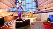The inside of Chef Mickey's with a host stand and buffet