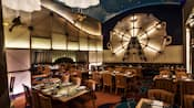 The Flying Fish with set tables, chairs a Ferris wheel decor and fish hanging from the ceiling
