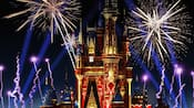 Fireworks bursting over a castle