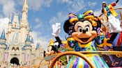 Mickey and Minnie waving on a float for the Move It Shake It Dance and Play It street parade