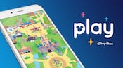 """La pantalla de un smartphone muestra un mapa de Walt Disney World y las palabras superpuestas """"Play Disney Parks"""""""