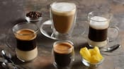 An assortment of 4 coffee drinks in various size glasses