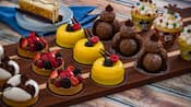 A selection of artfully designed desserts and pastries on a tray